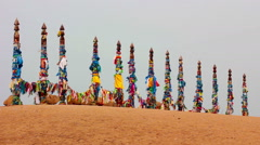 Serge. Sacred poles with colored ribbons in island Olkhon. Burkhan, Lake Baikal Stock Footage