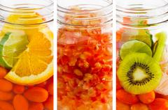 Delicious refreshing drink of mix fruits vertical stripes, infusion water Stock Photos