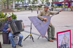 A man playing a balalaika in a Luxembourg square Stock Photos