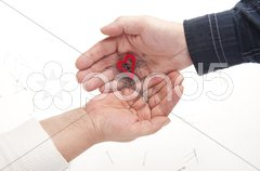 Two hands with heart and needles Stock Photos