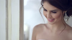 Bridal morning. Young woman sit on the platform and look to the window. Stock Footage
