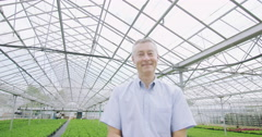 4K Business manager in the agricultural industry holding out a young seedling Stock Footage