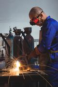 Male welder working on a piece of metal Stock Photos