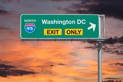 Washington DC Exit Only Freeway Sign with Sunrise Sky Stock Photos