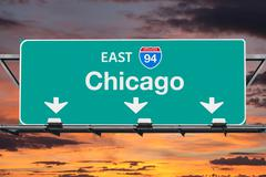 Chicago Interstate 94 East Highway Sign with Sunrise Sky Stock Photos