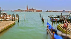 VENICE, ITALY - AUGUST 15: Gondolas and boats pass by on the Canal in time lapse Stock Footage