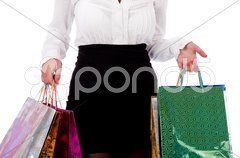 Woman holding shopping bags half length shot Stock Photos