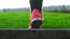 4K Low angle view of the feet of a female athlete walking through natural enviro Stock Footage
