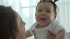 Baby Loving to be Tossed Up and Down Stock Footage