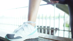 4K Woman doing stretches to prepare for her workout in the city Stock Footage