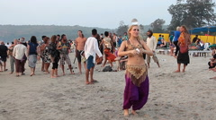 Woman juggling with glass ball on the beach Stock Footage