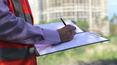 Construction Engineer Makes Notes on your Tablet Stock Footage