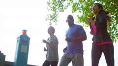 4K Fitness instructor with 2 female clients going for a run in the city Stock Footage