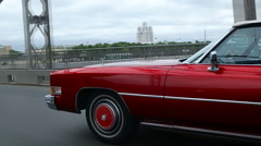 Red old 1964 Cadillac rides on Bolsheokhtinsky bridge Stock Footage