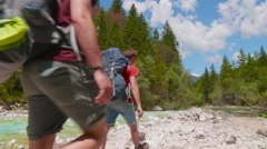 Hikers Taking on a Rocky Foothpath Stock Footage
