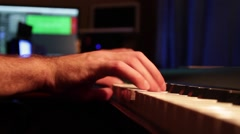 Close up of man hands playing on the piano and recording himself to the computer Stock Footage