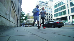 4K Fitness couple running together in urban city environment Stock Footage