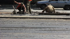Urban workers repairing the tram rails Stock Footage