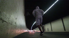 4K Black male athlete in training, running through urban environment Stock Footage