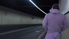 4K View from behind of athletic figure in urban environment Stock Footage