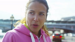 4K Female runner in the city takes a break and drinks from a bottle of water Stock Footage