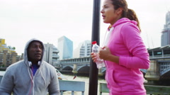 4K Fitness instructor training with female client in the city Stock Footage