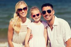 Happy family in sunglasses on summer beach Stock Photos