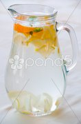 Pitcher with water and fruits Stock Photos