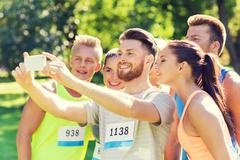 teenage sportsmen taking selfie with smartphone - stock photo