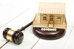 Auction. Law. Miniature House on wooden table and Court Gavel Stock Photos