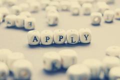 Apply word written on wood cube Stock Photos