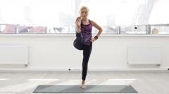 Woman doing yoga exercise Stock Footage