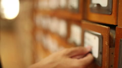 Man finding needful information in catalog in a library, close up  2 Stock Footage
