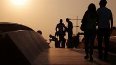IZMIR - TURKEY, JUNE 2016: People enjoying on beautiful wooden bridge at sunset Stock Footage
