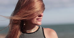 Young female with wind in hair Stock Footage