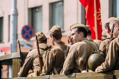 Side View Men In Disguise Soviet Soldiers WW2 Time. Victory Day Stock Photos