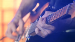 Guitarist stratocaster on stage for background, colorful, soft focus and blur Stock Footage