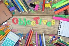 Objectives word and office tools on wooden table Stock Photos