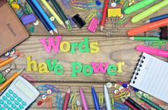 Words have power word and office tools on wooden table Stock Photos