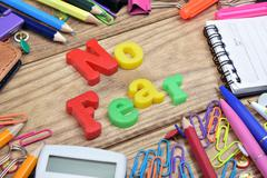 No fear word and office tools on wooden table Stock Photos
