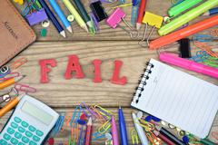 Fail word and office tools on wooden table Stock Photos