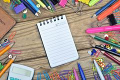 Notepad and office tools on wooden table Stock Photos