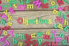 Objectives on wooden table Stock Photos