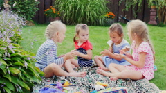Group of children playing on the lawn near the house. Socialize, molded from Stock Footage