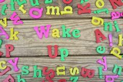 Wake up on wooden table Stock Photos