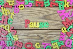 Pause on wooden table Stock Photos