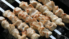 Barbecue skewers with meat on the brazier. Chicken shish kebab Stock Footage