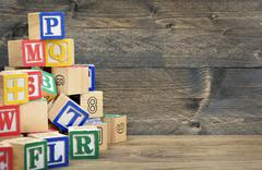 Block letters on table Stock Photos