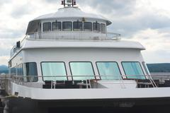 Boat ship tourism cruise port anchored front view Stock Photos