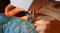 Hands of woman sewing on sewing machine. Zipper repair Stock Footage
